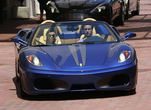 Scott and Kourtney Kardashian in a Ferrari Scuderia