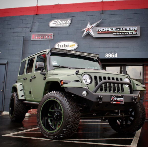Amber Rose green jeep