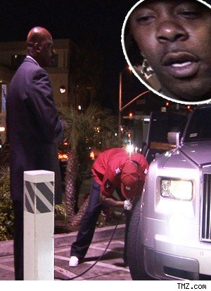 Busta Rhymes Filling The Tires in His Rolls Royce