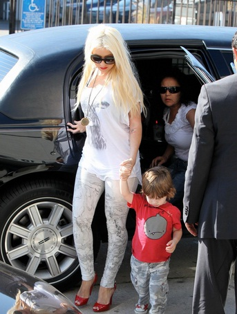 Christina Aguilera & Max out of their Lincoln Town Car