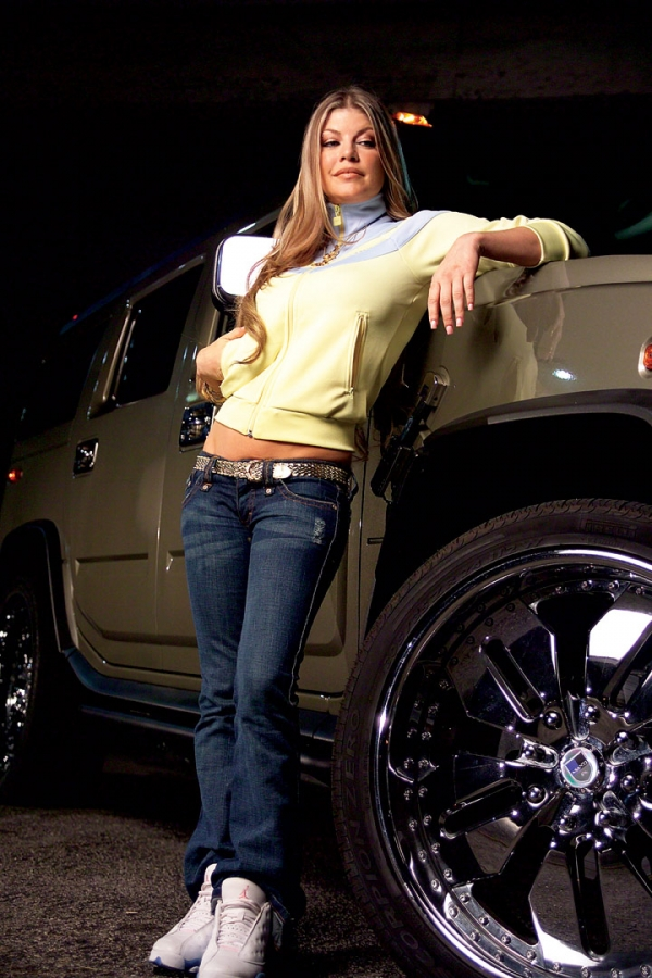 Fergie poses with her Hummer H2