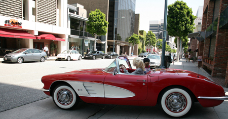 Holly drives a Vintage Corvette