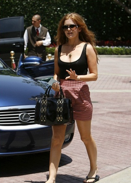 Isla Fisher walk past her luscious Lexus