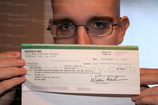 Jeremy Schoemaker shows off his check