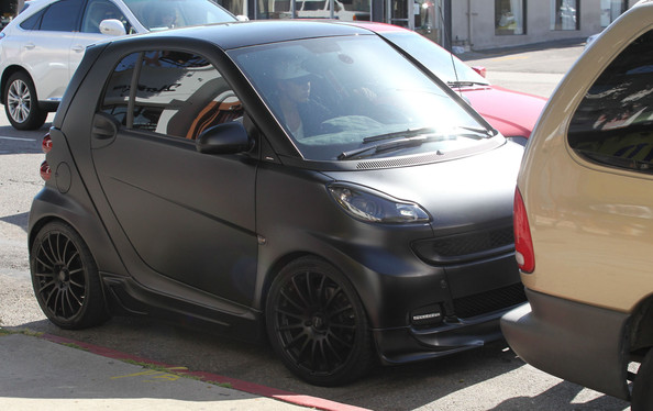 Justin In His Blacked Out Smart Car