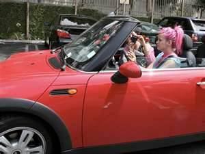 Lily Allen in a Mini-Cooper