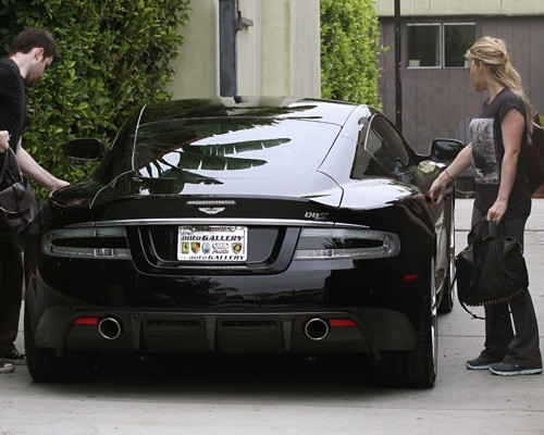 Mike Comrie picks up Hilary in his Aston Martin DBS