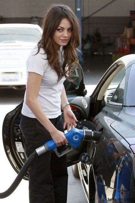 Mila Kunis is seen gassing up her Lexus-SC-430G