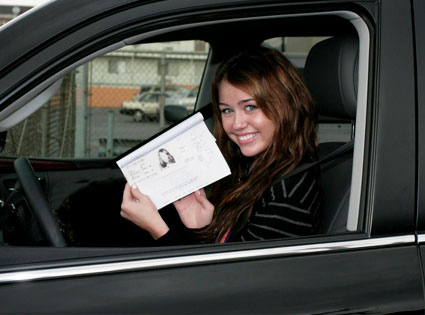 Miley Cyrus shows off  driver's permit.