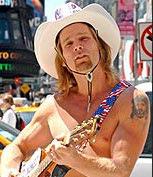 Naked Cowboy drives an Escalade!