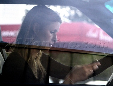 Nicky Hilton texting in her GMC Yukon