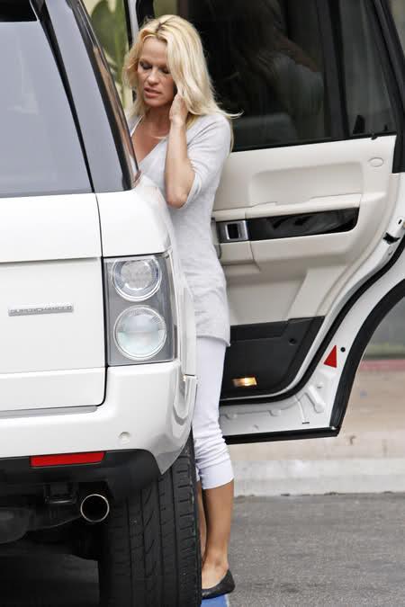 Pamela Anderson, crispy in  Range Rover