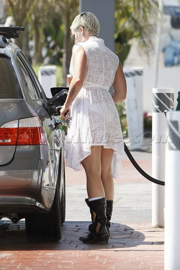 Pink Gasses Up her BMW Wagon