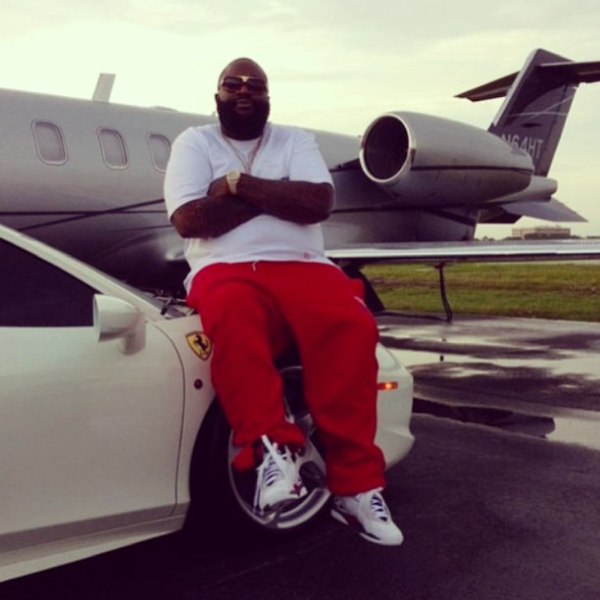 Rick Ross Sitting on a Ferrari