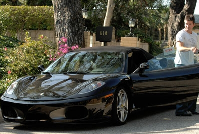 Simon Cowell Driving His Ferrari