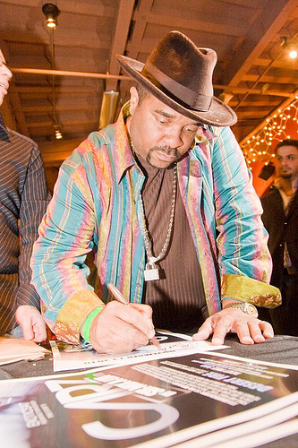 Sir-Mix-Alot signs autographs at the party.