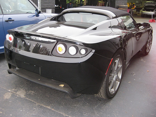 Will.I.Am picks up a new Tesla Roadster.