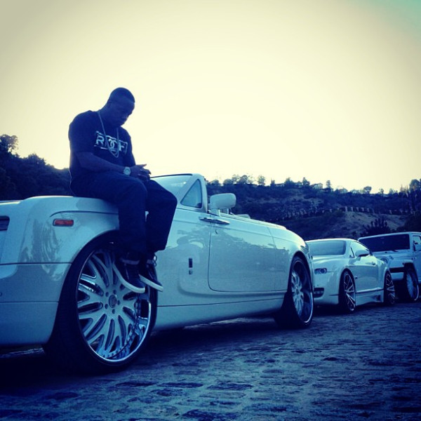 Yo Gotti Sitting on Rolls Royce