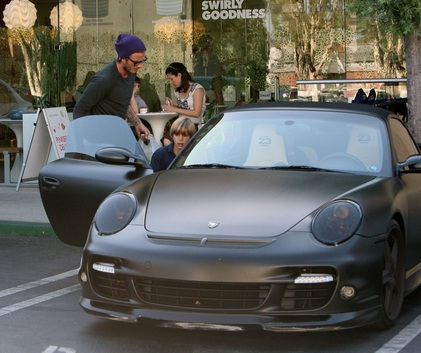 David Beckham taking a spin to pinkberry in his Porsche