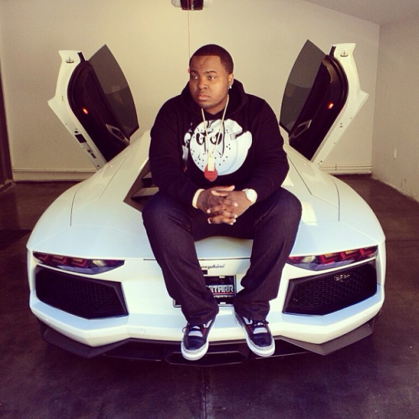 sean kingston sitting on a Lamborghini Aventador